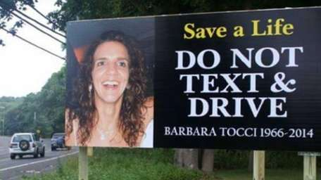 A billboard sign on Flanders Road shows Barbara