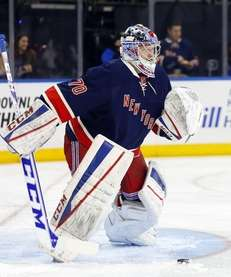 MacKenzie Skapski of the New York Rangers warms
