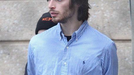 Nicholas Patrikis, 23, of Huntington, is in custody