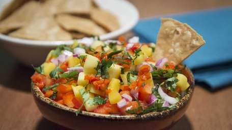 Yucateco guacamole, with mango, habenero chiles, red onion,