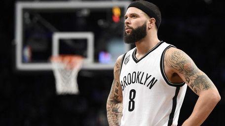 Brooklyn Nets guard Deron Williams looks on against