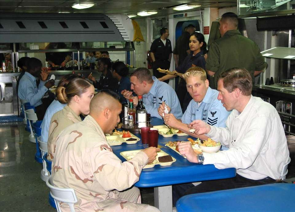 NBC anchor Brian Williams dines with servicemen aboard