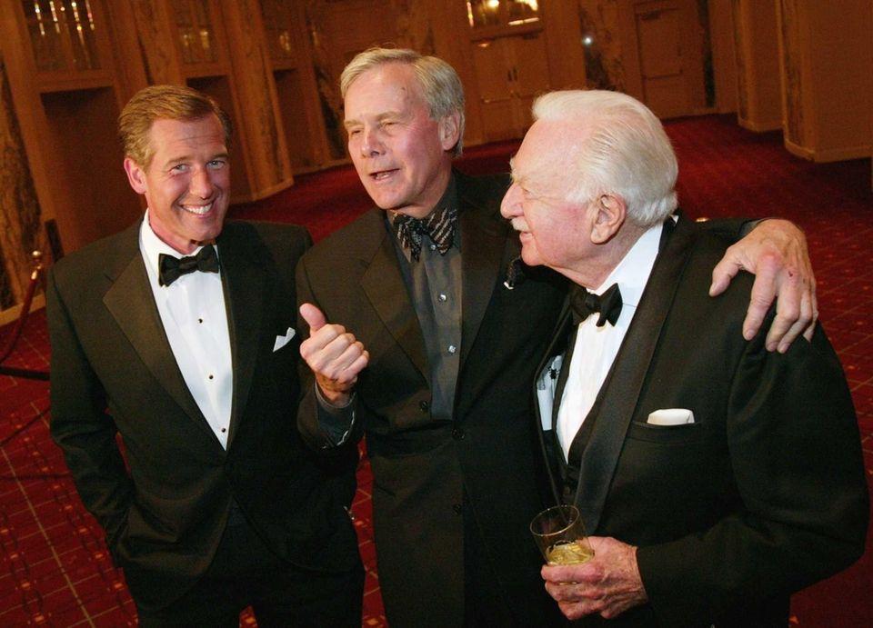 TV news anchors Brian Williams, left, Tom Brokaw