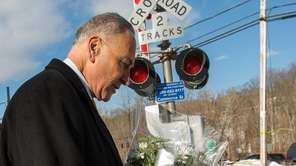 U.S. Senator Charles Schumer places flowers Feb. 6,