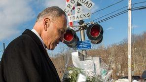 U.S. Senator Charles Schumer places flowers Feb. 6,