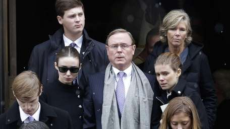 Chris Mara, center, with his daughters Rooney, left,