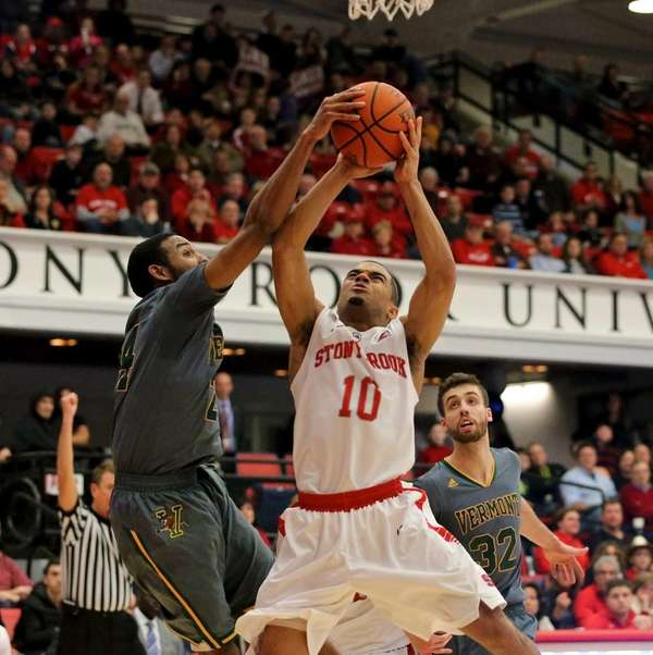 Stony Brook guard Carson Puriefoy gets fouled on