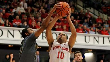 Stony Brook guard Carson Puriefoy gets fouled on