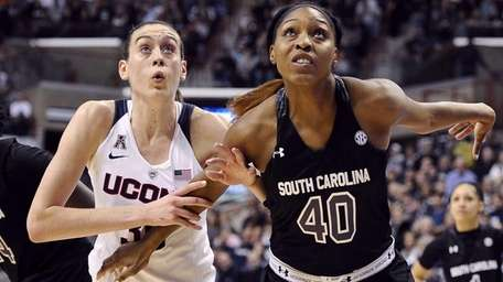 Connecticut's Breanna Stewart, left, and South Carolina's Jatarie