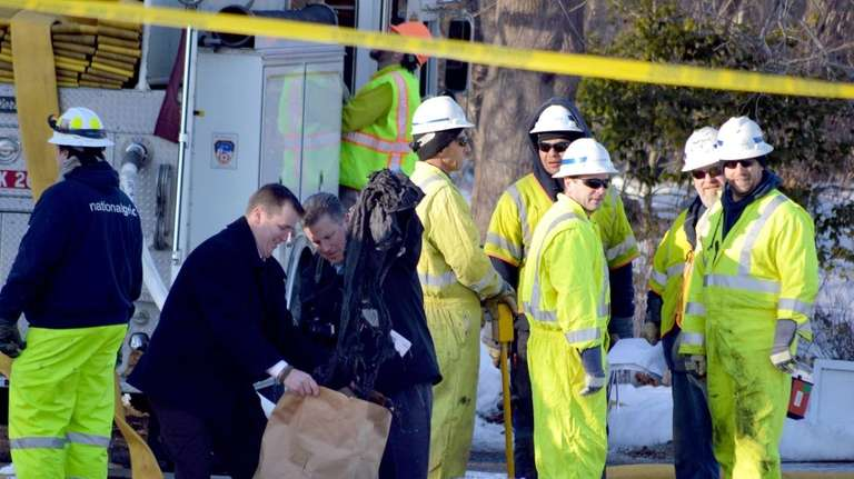 Emergency workers respond to the explosion of a