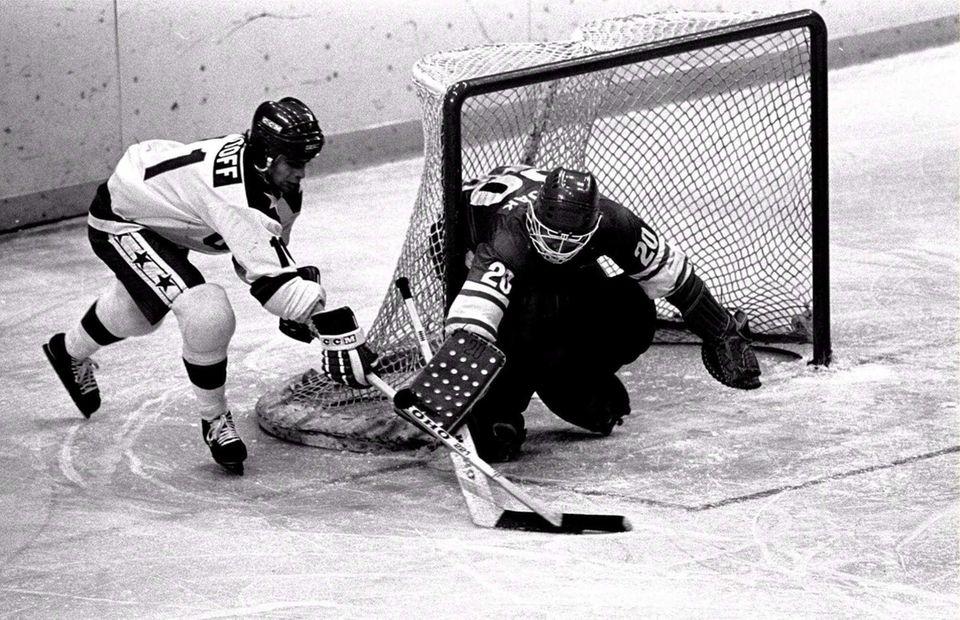 USA's Steven Christoff, left, attacks the Soviet goal