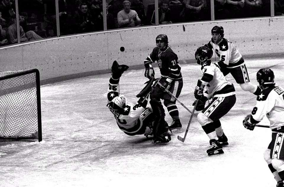 U.S. goalie Jim Craig reaches for the puck