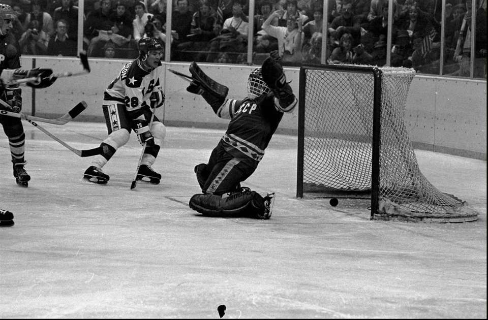 The puck goes past Soviet goalie Vladimir Myshkin