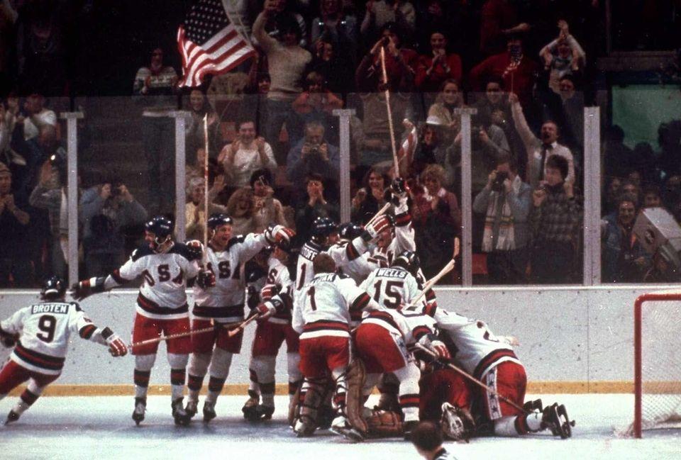 The U.S. hockey team pounces on goalie Jim