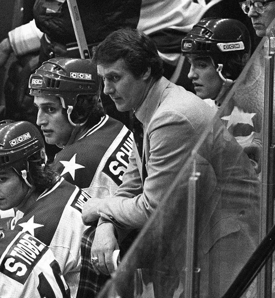 USA coach Herb Brooks, center, looks on from