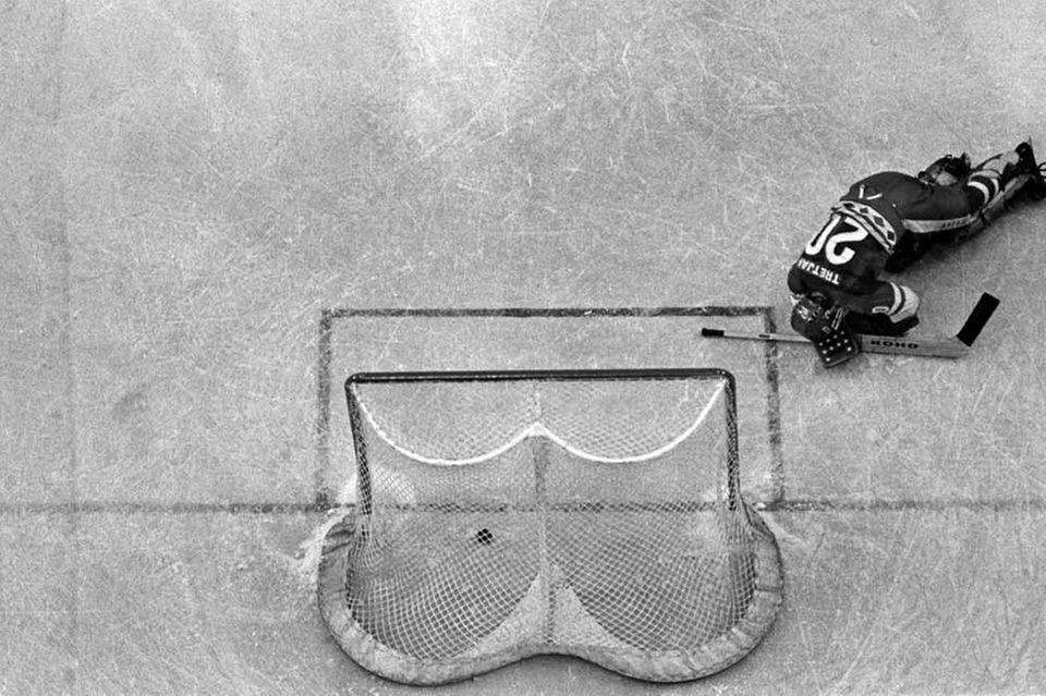 Soviet goalie Vladislav Tretiak hits the ice after
