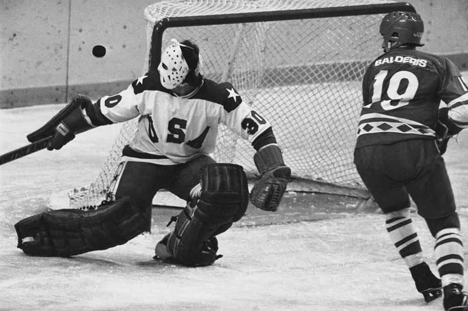 USA's Jim Craig deflects a shot by Soviet