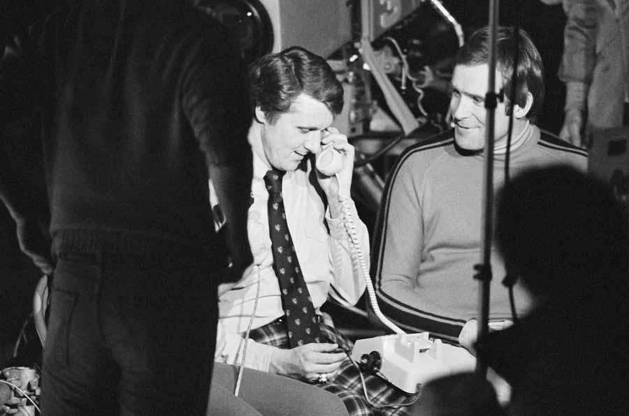 Coach Herb Brooks, receives a phone call from