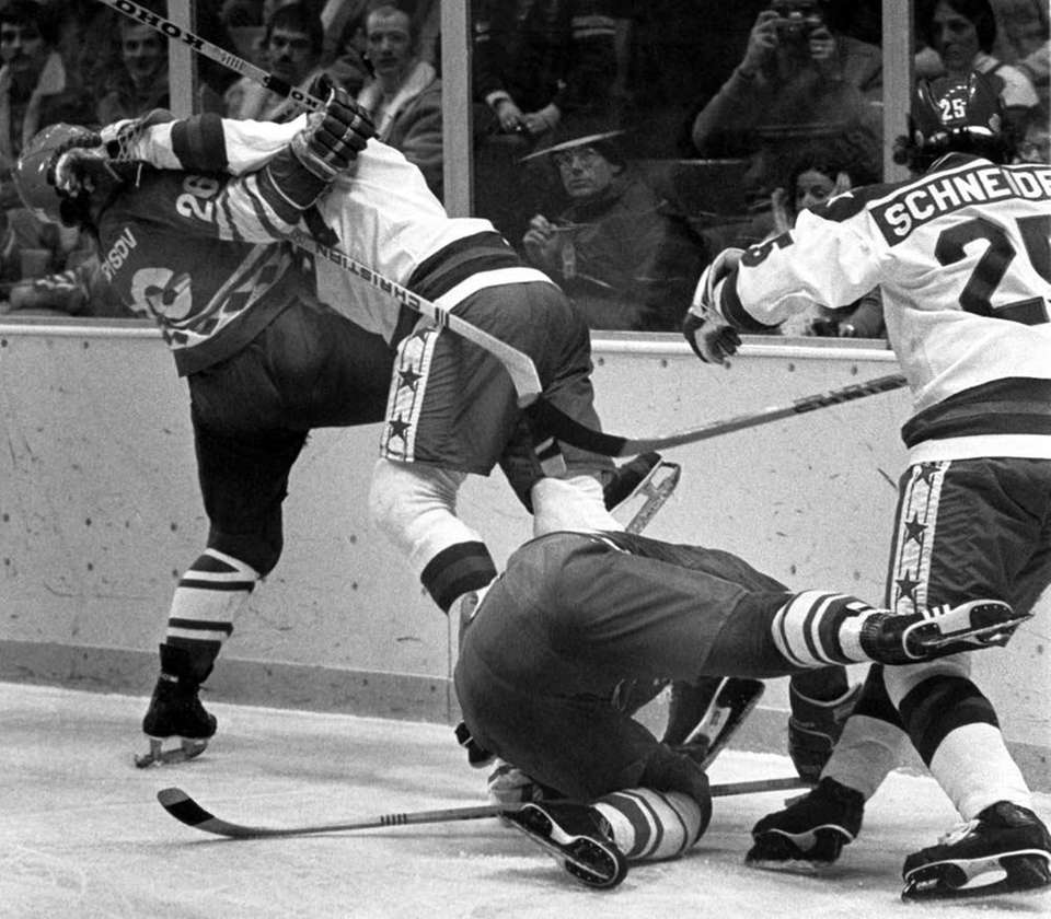 USA's Robert McClanahan crashes into Aleksandre Golikov of