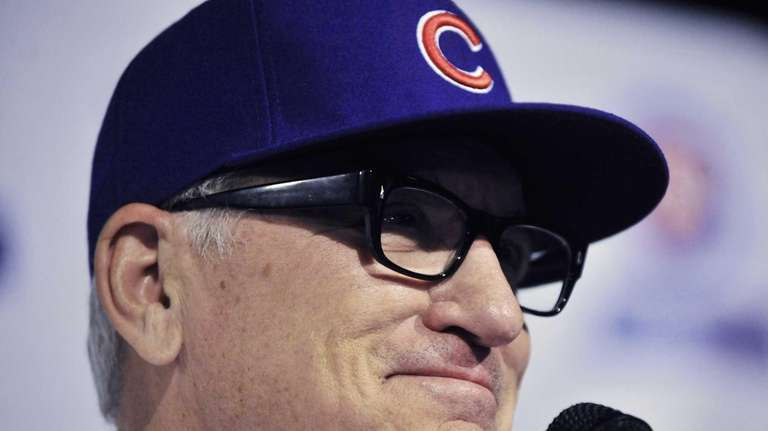Chicago Cubs manager Joe Maddon answers questions during