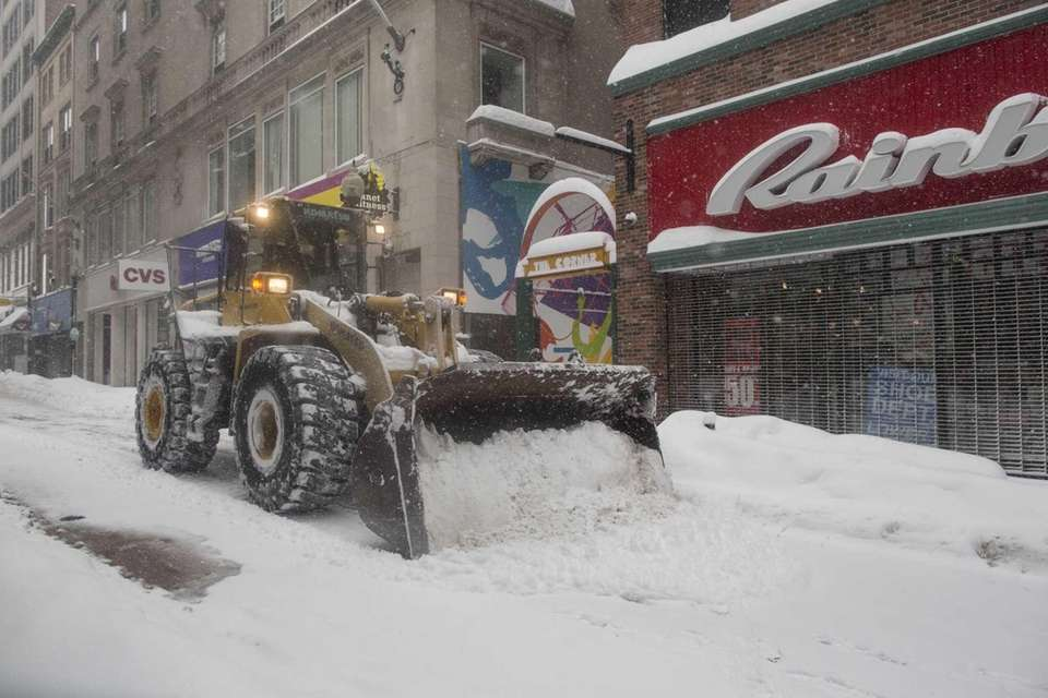 A front loader plows the Downtown Crossing area