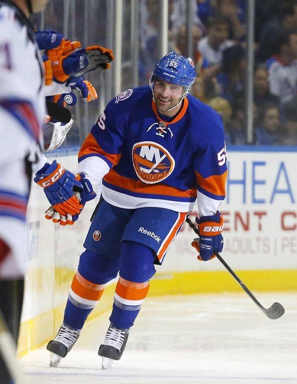 Johnny Boychuk of the New York Islanders celebrates
