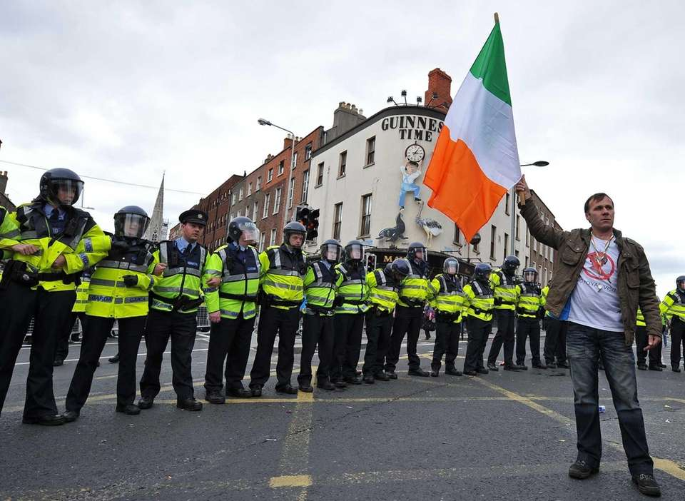 Irish Gardai form a police line behind a