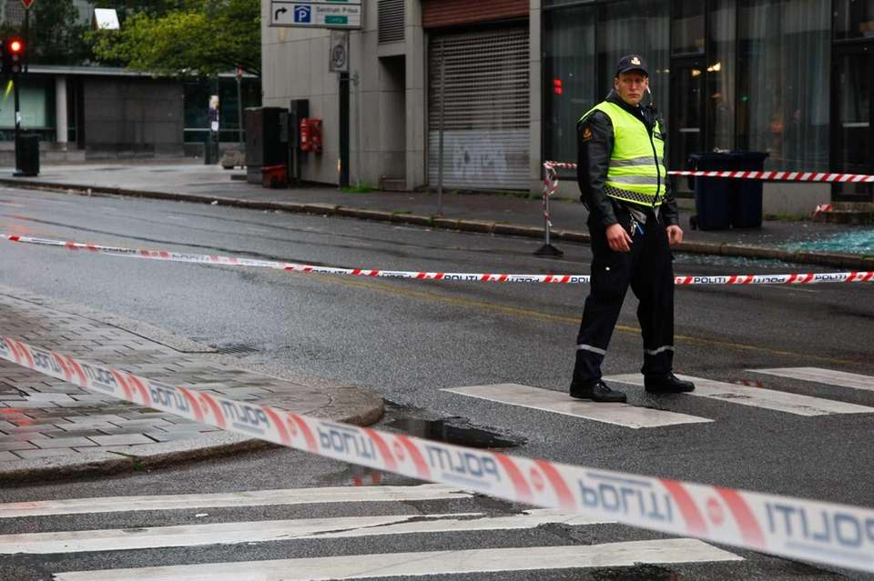 A Norwegian policeman stands at the cordoned off