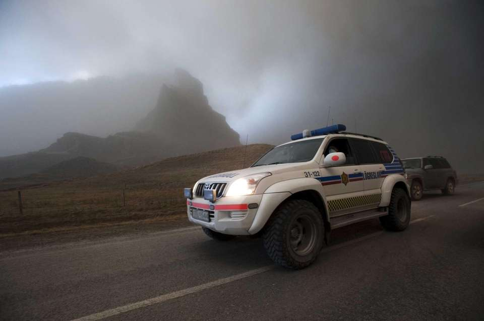 An Icelandic police vehicle drives along a road