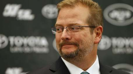 Jets general manager Mike Maccagnan addresses the media