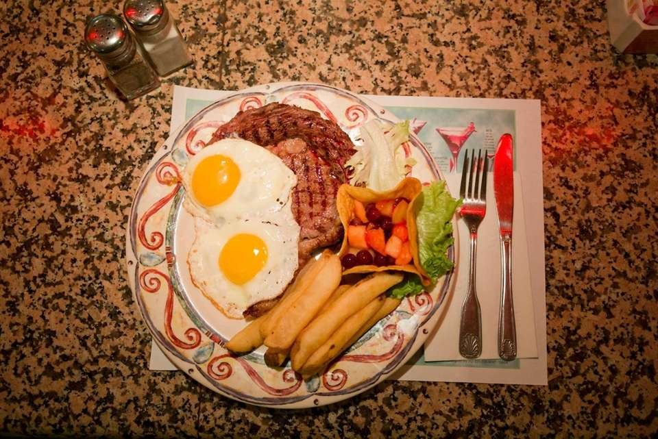 Ribeye steak and eggs are served at the