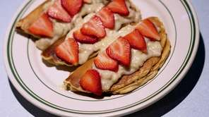 Banana-stuffed pancakes with strawberries are a favorite at