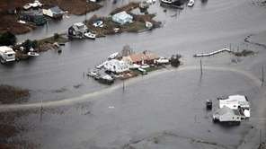 Flooding from superstorm Sandy damaged many homes on