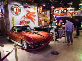 Visitors take in the collection of classic cars,