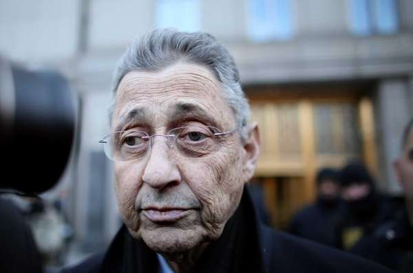 New York State Assembly Speaker Sheldon Silver walks