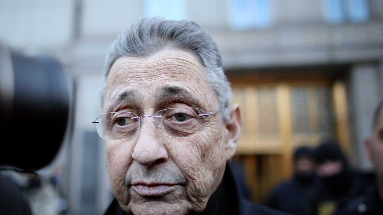 New York State Assembly Speaker Sheldon Silver walks