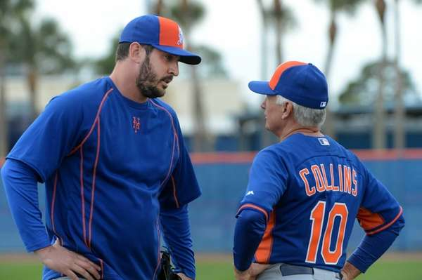 Mets pitcher Matt Harvey, left, talks with manager