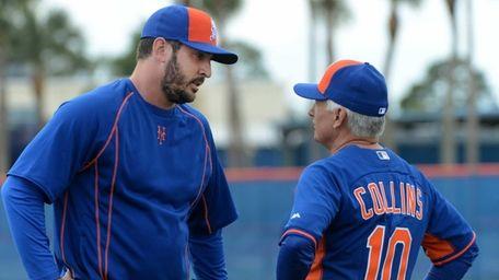Mets pitcher Matt Harvey, left, talks with manager