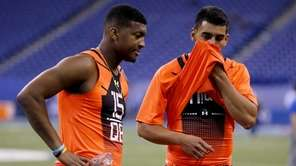Florida State quarterback Jameis Winston, left, stands with