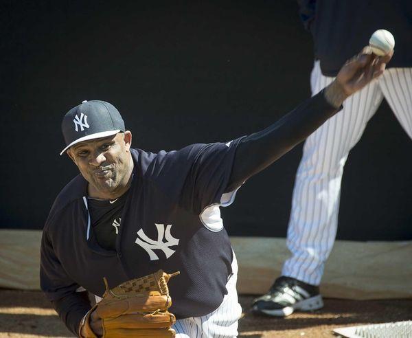 New York Yankees' CC Sabathia throws in the