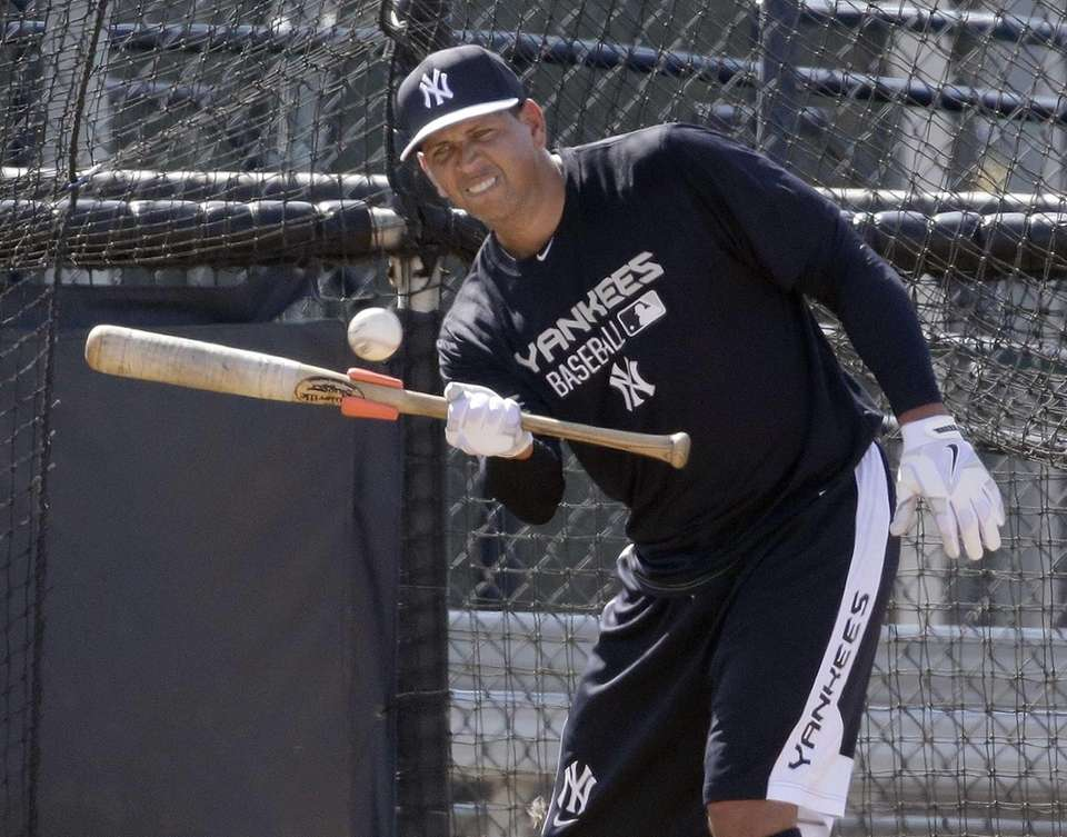 Alex Rodriguez bunts the ball while taking batting