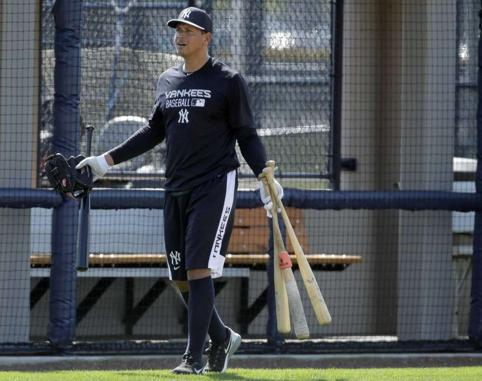 Alex Rodriguez gestures after working out at the
