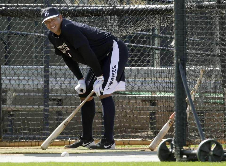 Alex Rodriguez takes a break while working out