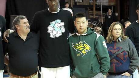 Cheick Diallo poses with his host family Mike