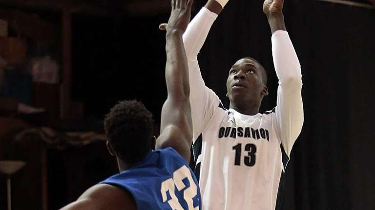 Cheick Diallo shoots over his opponent during a