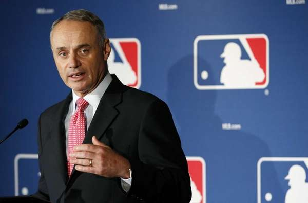 MLB commissioner Rob Manfred pauses as he answers