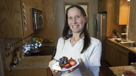 Jane Baldwin of Copiague tops her homemade avocado