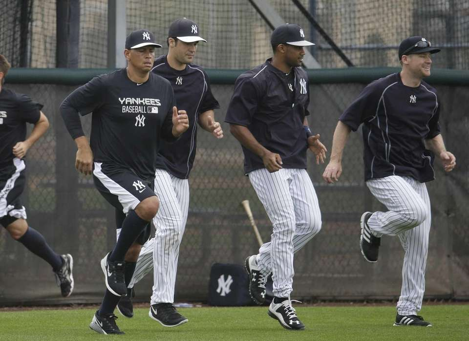 The Yankees' Alex Rodriguez, left, runs with his