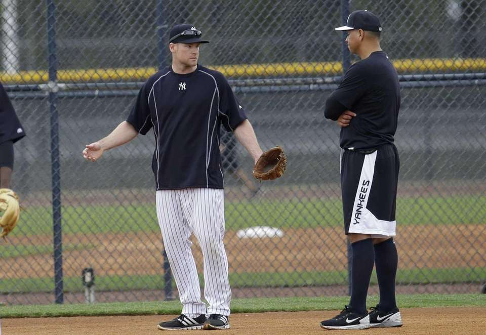 The Yankees' Alex Rodriguez, right, talks with third