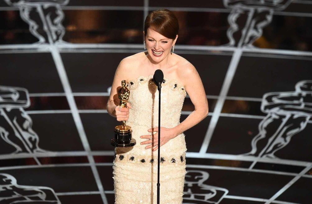 Julianne Moore, accepting the Oscar statuette she won
